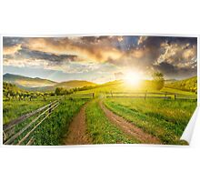 road and wooden fence on hillside at sunset Poster