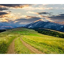 Winter in mountains meets spring in valley Photographic Print