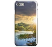 forest and river near the village in mountain at sunset iPhone Case/Skin