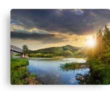 forest and river near the village in mountain at sunset Canvas Print