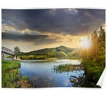 forest and river near the village in mountain at sunset Poster