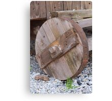 the old wooden wagon wheel Canvas Print