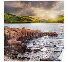 mountain lake with rocky shore at sunset Poster