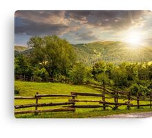 wooden fence on hillside at sunset Canvas Print