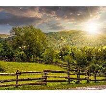wooden fence on hillside at sunset Photographic Print