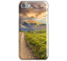gravel road to high mountains at sunset iPhone Case/Skin