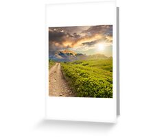 gravel road to high mountains at sunset Greeting Card