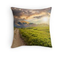 gravel road to high mountains at sunset Throw Pillow