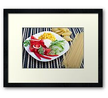 Slices of fresh raw vegetables on a striped background Framed Print