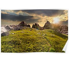path through boulders on hillside at sunset Poster