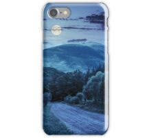 fence near road down the hill with  forest in mountains at night iPhone Case/Skin