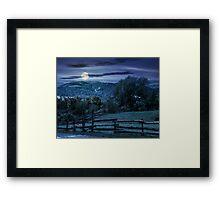 wooden fence on hillside at night Framed Print