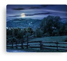 wooden fence on hillside at night Canvas Print