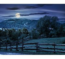 wooden fence on hillside at night Photographic Print