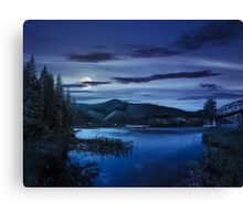 forest and river near the village in mounta at night Canvas Print