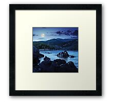 lake shore with stones near forest on mountain at night Framed Print