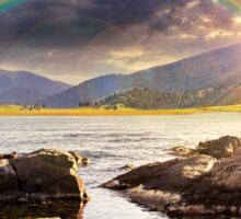lake with boulders in mountains at sunset Sticker