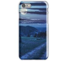 tree on hillside path through  meadow in foggy mountain at night iPhone Case/Skin