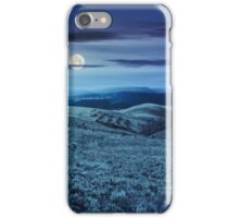 road on hillside meadow in mountain panorama at night iPhone Case/Skin
