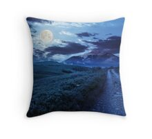 gravel road to high mountains at night Throw Pillow