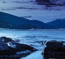 lake with boulders in mountains at night Sticker