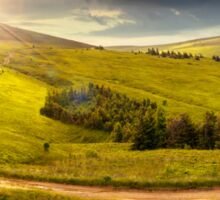 cross road on hillside meadow in mountain at sunrise at sunset Sticker