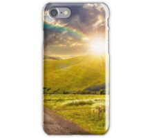 abandoned road through meadows in mountain at sunset iPhone Case/Skin