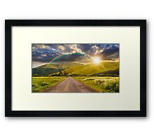 abandoned road through meadows in mountain at sunset Framed Print