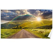 abandoned road through meadows in mountain at sunset Poster