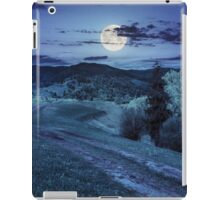 road on hillside meadow in mountain at night iPad Case/Skin