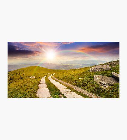 road on a hillside near mountain peak at sunset Photographic Print