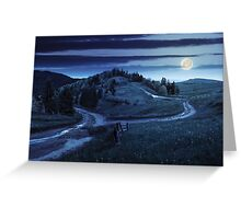 cross road on hillside meadow in mountain at night Greeting Card