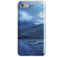 abandoned road through meadows in mountain at night iPhone Case/Skin