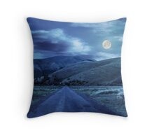 abandoned road through meadows in mountain at night Throw Pillow