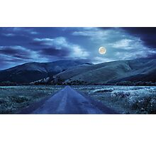 abandoned road through meadows in mountain at night Photographic Print