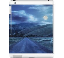 abandoned road through meadows in mountain at night iPad Case/Skin