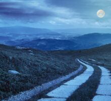 road on a hillside near mountain peak at night Sticker