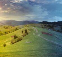 fence on hillside meadow in mountain Sticker