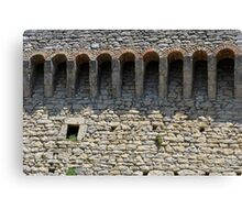 Stone wall with small structural arches Canvas Print