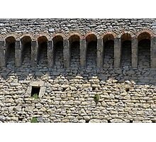 Stone wall with small structural arches Photographic Print