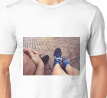 Couple sitting on the ground, detail of legs Unisex T-Shirt