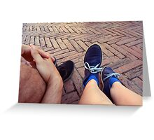 Couple sitting on the ground, detail of legs Greeting Card