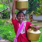 A woman's work - fetching water from the well by indiafrank