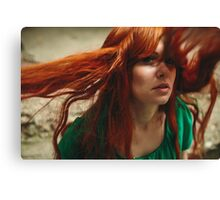 Beautiful ginger girl with deep green eyes and flying hair Canvas Print