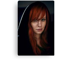 Dramatic portrait of beautiful red hair woman in black Canvas Print