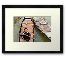 Trickster on the river Framed Print