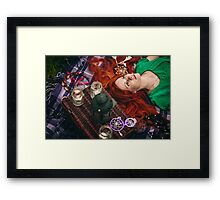 Beautiful red hair woman lying on plaid in grass Framed Print