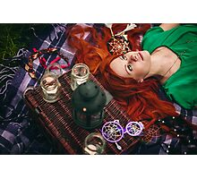 Beautiful red hair woman lying on plaid in grass Photographic Print