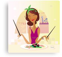 Exotic food Sushi. Girl with sushi in attractive japanese restaurant Canvas Print