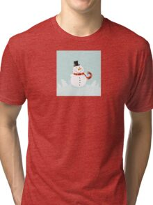 Christmas winter snowman. Cute snowman in christmas snowy nature. Tri-blend T-Shirt